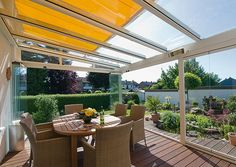 Love the idea of retractable glass with a bright awning!