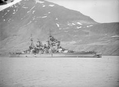 14 in Home Fleet flagship HMS King George V with severe bow damage after cutting destroyer HMSPunjabi in two in dense fog on 1 May 1942 - photo taken at Seydisfjord, Iceland.  She was lead ship of her class, designed to Washington Treaty limits: many pictures of her and her four sisters on this Board.