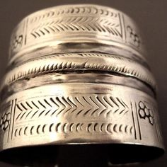 """Silver, Egypt This egyptian silver cuff from desert (Oasis of Siwa) with nice design and engravings is from the first half of the 20th century... you also can find this type of bracelet with different engravings in Sudan and Libia...Splendid patina and beautiful seals of origin attest oldiness of this bracelet ...! Weight:64gr Height:1,96 inch Diameter::Adaptable For sale at my shop at 28, Galerie du Roi at 1000 Brussels and on www.halter-ethnic.com, item """"My Lucky Finds"""""""