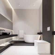 salle de bains claire avec un éclairage led indirect, sanitaire blanc et accents en bois sombre