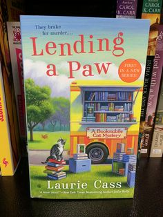 It looks like my kind of series.  Cozy mystery with cats and libraries.  Cool!  I should give it a try.