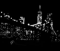A night engagement photo taken in Brooklyn at the Brooklyn Bridge Park in DUMBO, by BOM Photography, a husband and wife New York #wedding photography team.   Tilt shift lens.