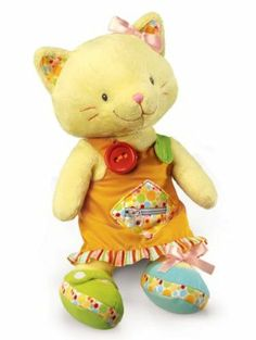 """Russ Berrie Babies Love To Learn 16"""" Kitten Activity Doll by Russ Berrie. $29.99. Measures 16"""" standing, 10"""" sitting. Baby safe. Surface washable. Stitched eyes. Teaches basic dressing skills: snap button, zip, tie and Velcro. From the Manufacturer                This adorable and sweet kitten is dressed in a removable dress with a pink hair bow. You can help teach your child basic dressing skills including: to button, snap, tie a bow, zip and includes """"crinkle pap..."""