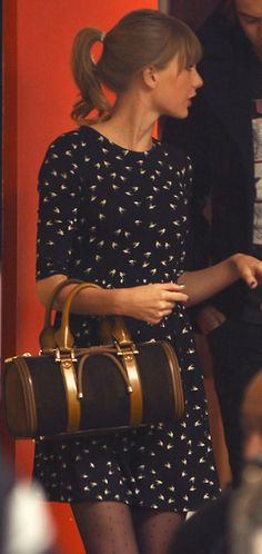 Black and white print dress with pin dot tights - out with Harry Styles at a tattoo parlour