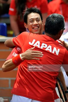 Kei Nishikori of Japan celebrates with his captain Minoru Ueda after defeating Colombia's Santiago Giraldo during the Davis Cup World Group Play-off singles match between Santiago Giraldo of Colombia and Kei Nishikori of Japan at Club Campestre on September 20, 2015 in Pereira, Colombia.