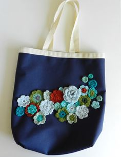 Freebie::: Upcycled canvas bag with crochet! brilliant idea, link to freebie flowers pattern. Genius idea for those bags you get free that you will never use. Thanks so! xox