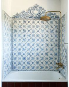 Fabulous tub enclosure done with Portuguese patterned tile.