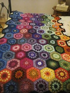 Finally finished my first hexagon throw - thanks to Lavender  and Wild Rose  for the crochet starburst hexagon pattern.