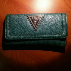 Blue Guess wallet Blue-green wallet. Good quality with just a few minor cracks in the material. Left side of the upper portion was ripped, but I fixed it and it works like new. Feel free to ask questions! Guess Bags Wallets