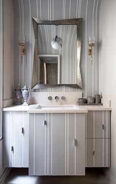 uneven stripe pattern on accent wall and bath cabinet, whimsical mirror frame