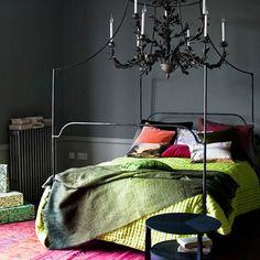 moody colour unstructured bedroom in pink, orange, greens and slate