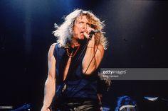 1995, British rock singer Robert Plant performs onstage.