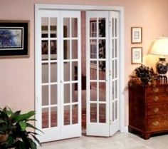 Bifold french doors.  Would love to build a small wall to create a hall between the living/dining room and  the bedrooms/family room. Add these to separate the areas when necessary.