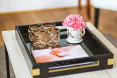 Gold & black coffee table styling