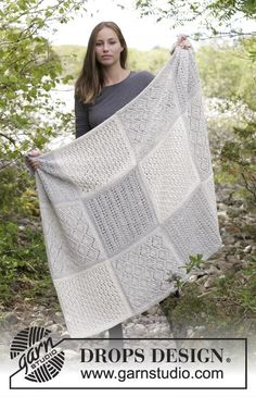 Twelve Clouds - Knitted blanket with squares in lace pattern. Piece is knitted in 2 strands DROPS Alpaca. Free knitted pattern DROPS 181-32