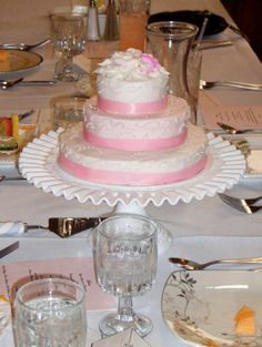 """Each talbe had it's own little wedding cake on it inspiring a """"cake crawl"""" at my bridal shower."""