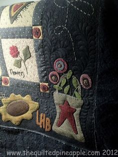 Love the quilting--a couple of feathers with meanders