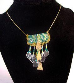Green beaded tube with pendant crystals and metallic triangles. Crystals, Triangles, Pendant, Green, Tube, Metallic, Jewelry, Fashion, Moda