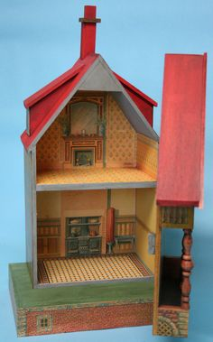 """Interior of the Bliss Keyhole Dollhouse Kit No. 4. This dollhouse stands 19"""" High."""