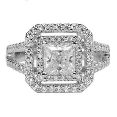 ArtCarved Diamond engagement ring featuring a petite prong double diamond halo and diamond enhanced split shank band.