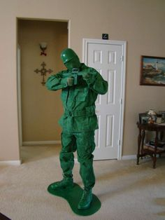 Army Man Costume-- jacket, pants, boots, helmet, toy gun, plywood and 12 cans of green spray paint!