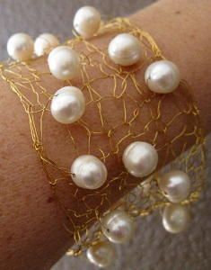 "Wire Pearl Bracelet - If you love unique knitting ideas, take a look at this Wire Pearl Bracelet. No yarn is required because this DIY bracelet is made by knitting wire. The great part about wire jewelry is that it has a chic city feel and the pearls in this pattern elevate it to an elegant metropolis look. Learn how to make jewelry that is going to wow your loved ones. Your friends will ""ooo"" and ""ahh"" over it so much that your search for homemade gift ideas is over."