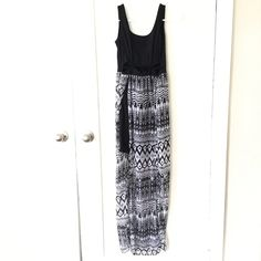 Black and white tribal dress with slits Tribal print dress with waist high slits (on both sides) and a mini skirt underneath. There are also cut outs around the waist. Forever 21 Dresses Maxi