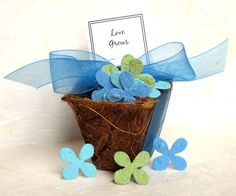 These are so cute! Seed Paper Wedding Favors - Plant-able Pots Kit Comes with a box, the biodegradable pot and the seed paper, ribbon, instruction card and wrapping tissue. You can do flowers or herbs.