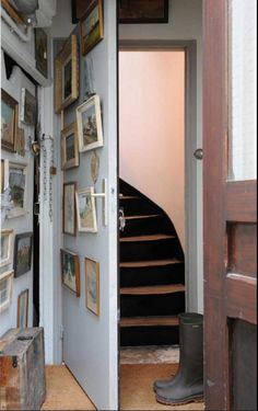 Cover any free space with photos and artwork.help hide a secret door by making it look like part of the wall. Hidden Spaces, Hidden Rooms, Small Spaces, Passage Secret, Secret Rooms, Paris Apartments, Stairway To Heaven, Victorian Homes, Stairways