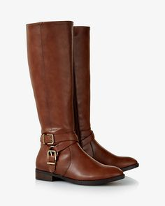 These boots deliver classic-chic riding style on a daily basis. Polished buckles draw the eye to your ankle, and the wide collar pairs easily with pants or tights for all-season wear. Add a crisp blazer when you want to really show off in the ring.