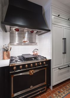 Beautiful range and hood with panelled refrigerator.