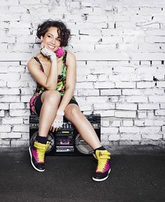 Alicia Keys wearing Reebok Freestyle