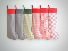 ... modern Christmas stockings, personalized christmas stockings ... family christmas stockings for boys or girls ... gray, green, red striped kids stockings ... Little Cuff Collection ...  M O D E R N . L I T T L E . C U F F . C H R I S T M A S . S T O C K I N G :  My Little Cuff Collection is a huge variety of fabrics, all applied to the same slim boot and finished off with a cuff in cheery cotton.  This listing is for one Little Cuff stocking in your choice of the fabrics shown. (To…