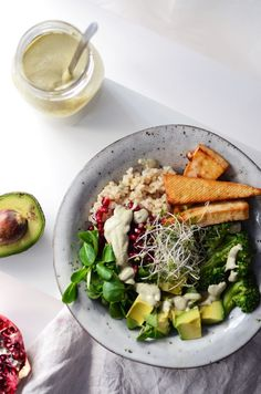 nourish bowl with tofu, brown rice, vegetables + pumpkin seed dressing
