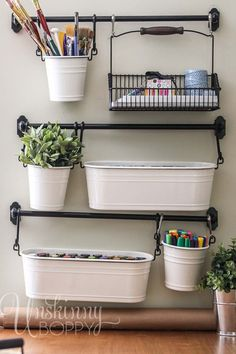 The IKEA Fintorp series of buckets and hooks turned out to be the perfect, pretty organization idea for my craft room! You can mix and match buckets, wire baskets and hooks to create any combination of storage solutions. Plus it's CUTE.
