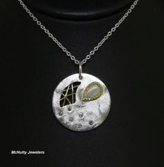 Our Master Jeweler created this unique sterling silver, opal, diamond, and 18kt yellow gold pendant for this year's Kidpower Chocoholic Frolic silent auction. We attended the event and enjoyed delicious food and chocolate from local chocolate vendors. We love supporting such a wonderful cause! McNulty Jewelers original design