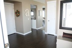 Dark wood floors, white trim and doors, wall color... Its all great!