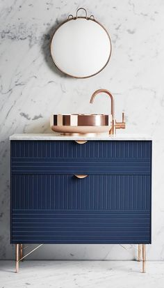Bathroom with a modern blue sink and rose gold fixtures http://www.uk-rattanfurniture.com/product/reclaimed-teak-hall-seat-with-shoe-storage-two-natural-wicker-basket-drawers-and-cushions/