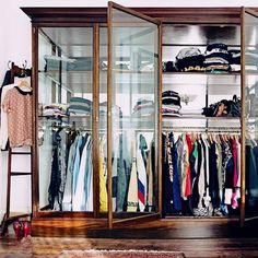 vintage display cabinet = modern closet