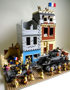 Allied troops march into the newly liberated -- though heavily damaged -- French city of Cherbourg, days after the Normandy invasion on D-Day. Lego Ww2, Lego Army, Marvel And Dc Superheroes, Lego Display, Toys Land, Lego Worlds, Lego Architecture, Lego Models, Lego Projects