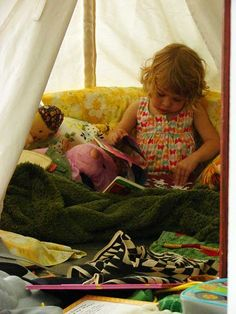 reading teepee filled with books and blankets and pillows