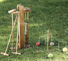 Modeled on authentic English croquet sets, our version is hand carved from mango wood and mahogany with painted details. Great for summertime outdoor family fun.