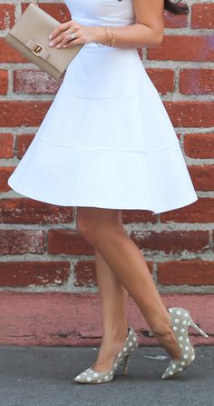 White skirt and polka dots heels