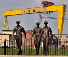 Titanic Yardmen sculpture, Belfast, Northern Ireland.A general view of the whole sculpture, from the other side of the Newtownards Road. A sculpture, by Ross Wilson, unveiled at Pitt Place (opposite Westbourne Presbyterian church), Ballymacarrett on 28 March 2012, by the First Minister Peter Robinson. It honours all generations of yardmen and is a tribute to their life and legacy.