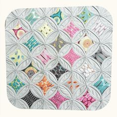 very stylish cathedral window made with a Mini Charm Pack of FOR YOU by Zen Chic for Moda