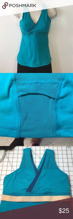 Lululemon turquoise bra top size 6 EUC This Lululemon top features mesh backing to stay cool, credit card/ID pocket in the center back, and a built-in bra with pads included. The main color is turquoise with navy accents. Tag has been clipped but the size 6 marker is clearly in place. It has been handled with care, no pilling or staining. Ready for the next owner to enjoy. lululemon athletica Tops Tees - Short Sleeve