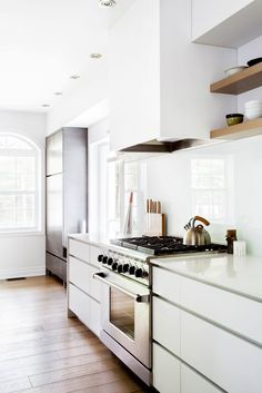 Interesting cover for the hood. Just a really sweet kitchen - desire to inspire - desiretoinspire.net