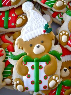 Love the teddy bear. Endless possibilities on hat and package decor and colors.  Decorated Christmas sugar cookie.  #cookieart #cookiedecorating