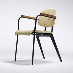 Jean Prouve  Compass chair,  Ateliers Jean Prouve France, c. 1953 enameled steel, oak, vinyl  22.5 w x 22.5 d x 30.5 h inches. s14.2