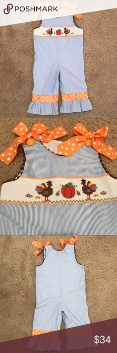Thanksgiving Smocked Romper Girl 24m 2T Adorable Thanksgiving smocked romper with precious shoulder bows! Great condition, only worn once, nonsmoking home. Tag says 24m... but fits a little more like 2T in my opinion. So cute for turkey day! Dresses Casual